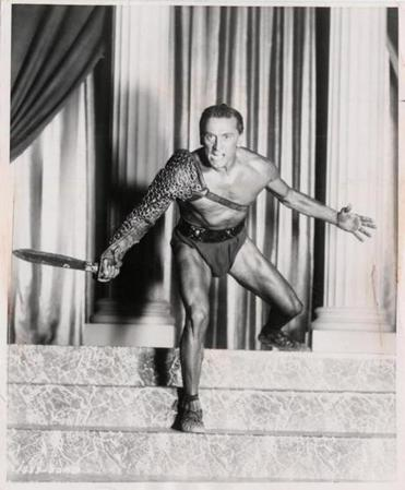 "Mr. Douglas produced and starred in Stanley Kubrick's ""Spartacus"" (1960). By giving writer Dalton Trumbo a credit, he helped end the Hollywood blacklist."