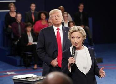 Clinton says her 'skin crawled' as Trump hovered on debate stage