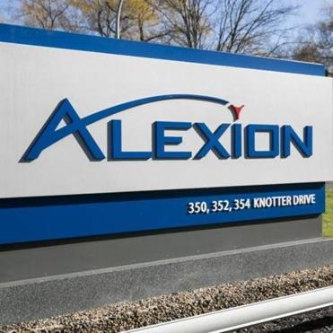 A logo sign outside of the headquarters of Alexion Pharmaceuticals Inc., in Cheshire, Connecticut on November 21, 2015. Photo by Kristoffer Tripplaar *** Please Use Credit from Credit Field ***