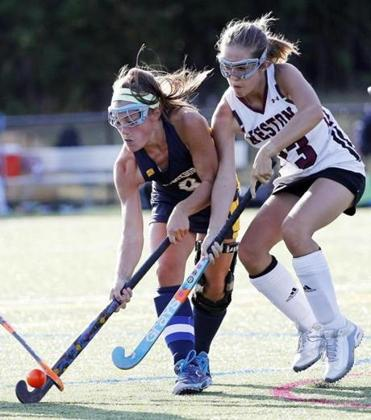 Acton-Boxboro's Emma Kearney, left, battles Weston's Glennie LeBaron for for the ball during their field hockey game in Weston, Mass., Tuesday, Sept. 12, 2017.(Winslow Townson for The Boston Globe)