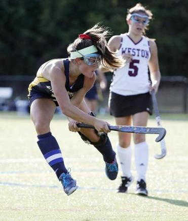 Acton-Boxboro's Emma Kearney lets go a shot against Weston during their field hockey game in Weston, Mass., Tuesday, Sept. 12, 2017.(Winslow Townson for The Boston Globe)
