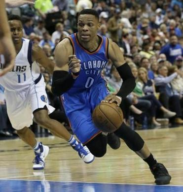 "File-This photo taken March 27, 2017, shows Oklahoma City Thunder guard Russell Westbrook (0) dribbling during the first half of an NBA basketball game against the Dallas Mavericks in Dallas. Westbrook has yet to sign an extension, but the reigning league MVP said Oklahoma City is where he wants to be and he is ""happy"" about the offseason additions of superstars Carmelo Anthony and Paul George. ""I love it here,"" he said. ""I like where I'm at, and I like where our team is at.""(AP Photo/LM Otero, File)"