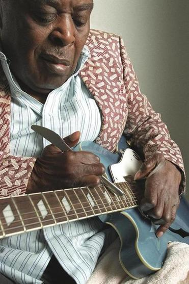 After polio constricted his hands, Mr. Davis developed his own technique of using a knife along his guitar's fretboard.