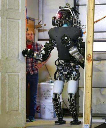 MIT professor Russ Tedrake watched the robot Atlas open a door in a campus building in 2015.