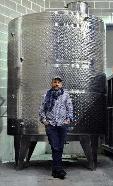 City Winery CEO Michael Dorf in front of a fermentation tank that was to be installed at the Boston location, which is slated to open Nov. 10.