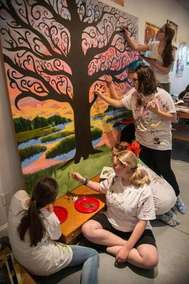 "19nomural - Clark School art honors students working on their 80-square-inch mural for the Salem Essex Probate and Family Court. The mural's tree represents a ""family tree,"" and is inspired by the adoption process. (Jeph Ellis)"