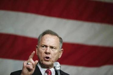 Roy Moore casts himself as a victim in US Senate race