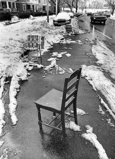 Space savers are a Boston tradition. Above: Chairs along Columbia Road in Dorchester in 1978.