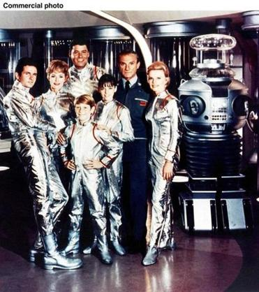 "The cast of the original TV series ""Lost in Space"" (from left): Mark Goddard, June Lockhart, Guy Williams, Billy Mumy (front), Angela Cartwright, Jonathan Harris, and Marta Kristen."