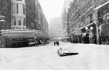 '78 BLIZZARD SLIDER Boston, MA - 2/6/1978: Boston's Washington Street is buried in snow on Feb. 6, 1978, during a blizzard. The storm dropped 23.6 inches of snow on Boston over 32 hours and 40 minutes, between Feb. 5 and 7. (David L. Ryan/Globe Staff) —- BGPA Reference: 140512_CB_006