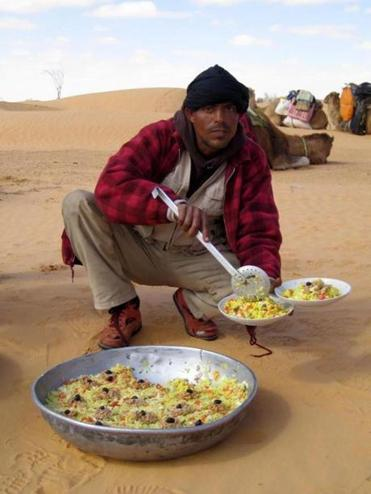 A cook preparing lunch in the Moroccan desert.