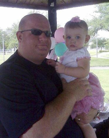 Aaron Feis (left) with an unidentified girl.