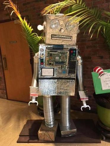 Webster School art teacher Nick DeRosa and his son constructed a robot for display in the school's lobby.