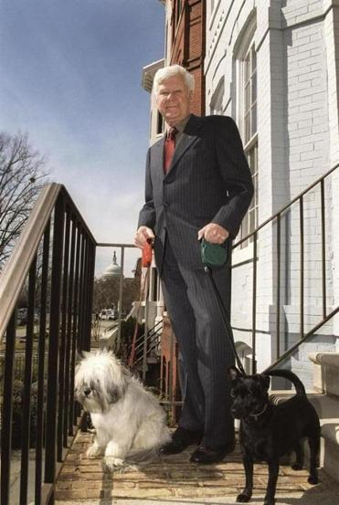 Dr. Melcher, who maintained his veterinarian's license while serving in Congress, stood with his dogs Ben (left) and Max outside his Washington home in 2002.