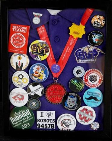 Alexandra's robotics teammates at Blackstone Valley Regional Vocational Technical High School framed a shirt and pins from a recent world competition for the Valoras family.