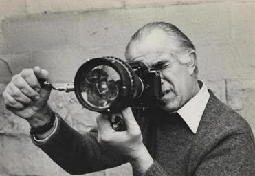 Photograph by Sheila Duncan. David Douglas Duncan looking through camera fitted with prismatic lens, between 1963 and 1972. Courtesy Harry Ransom Center.