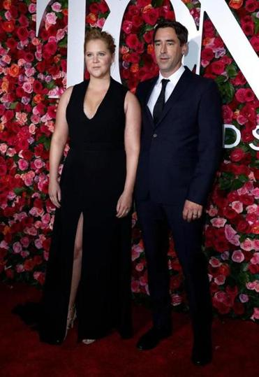 Amy Schumer and her husband, Chris Fischer, on the red carpet Sunday at the 2018 Tony Awards at Radio City Music Hall in New York.