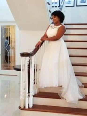 Dulce Gonzalez poses in her wedding dress on the Strunks' staircase. MUST CREDIT: Courtesy of Dulce Gonzalez.