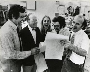 Gerard M. O'Neill, Thomas Winship, Ann Desantis, Stephen A. Kurkjian and Timothy Leland of The Boston Globe celebrate after receiving word that they won the 1972 Pulitzer for Local Investigative Specialized Reporting for their exposure of widespread corruption in Somerville, Massachusetts.