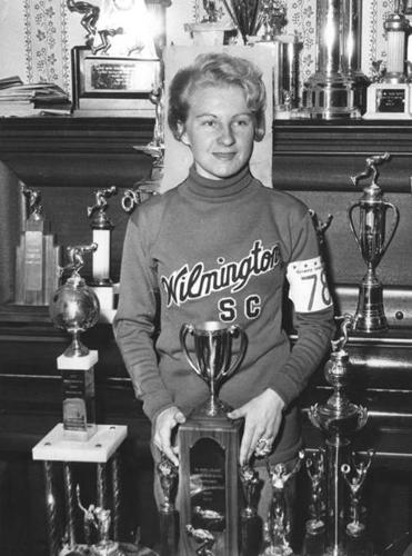 Jeanne Ashworth with a trophy from the Middle Atlantic Outdoor Speed Skating Championships in 1959.