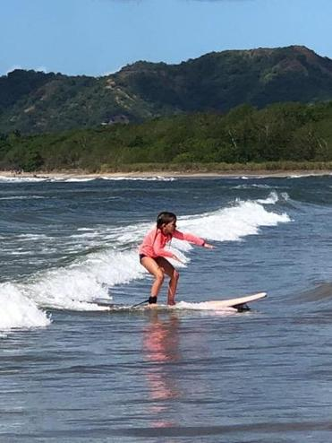 Lulu, 6, learning to surf at Witch's Rock Surf Camp.