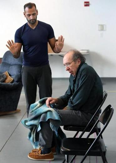 "Actors Shawn K. Jain (above left) and Ken Baltin rehearse a scene from New Rep Theatre's production of ""Heartland."""