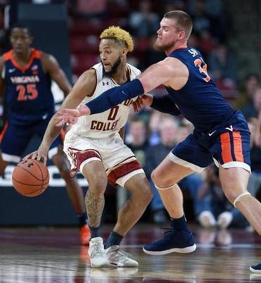 Chestnut Hill, MA 01-08-19: Virginia's Jack Salt (right) tries to take the ball away from BC's Ky Bowman (left) in first half action. The Boston College Eagles men's basketball team hosted Virginia at Conte Forum. (Jim Davis/Globe Staff)
