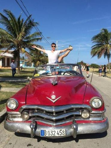 Hi Chris. Here is Tim Kelleher for The VIP Lounge. Photo in red car is in Cuba and one with snakes is in Morocco.