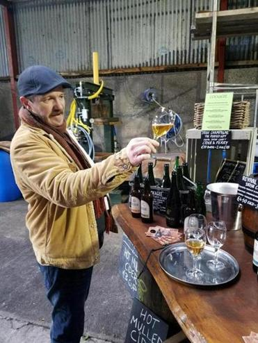 Owner Mark Jenkinson holds a glass of Cider Mill Slane's Cockagee.