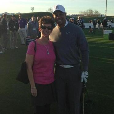 Jane Spicer, CEO of Phoenix-based Daphne's Headcovers, and Tiger Woods.