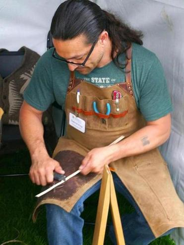 Passamaquoddy basketmaker Gabriel Frey demonstrates the creation of an ash splint for traditional basketry.
