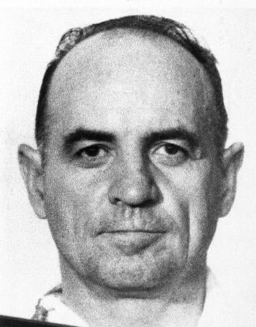 Mr. McCord, shown in his mugshot, was a CIA agent before Watergate's break-in.