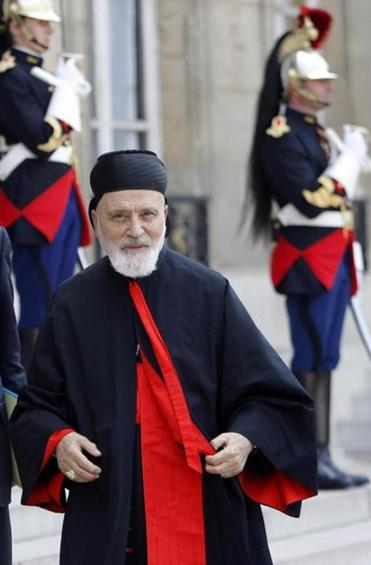 FILE - In this June 16, 2010 file photo, Cardinal Nasrallah Butros Sfeir, head of Lebanon's Maronite Church, arrives for a meeting with French President Nicolas Sarkozy at the Elysee Palace. Lebanon's Maronite Christian church says its former patriarch Cardinal Nasrallah Butros Sfeir has died after days in hospital. He was 98.(AP Photo/Christophe Ena, File)