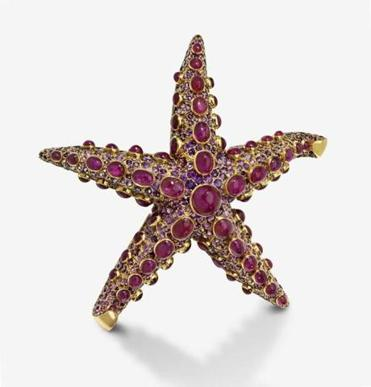 25namesmfa - *ONE TIME USE*** - Starfish brooch, Designed by: Juliette Moutard (French), For: René Boivin (French, founded in 1890), Fabricated by: Charles Profilet (French), Worn by: Claudette Colbert (American (born in France), 1903 – 1996). French, 1937. 18‑karat gold, ruby, amethyst. (Museum of Fine Arts, Boston)