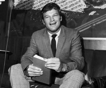 "FILE - In this Aug. 11, 1970 file photo, New York Yankees pitcher Jim Bouton, holds a copy of his book ""Ball Four"" in New York. Jim Bouton, the New York Yankees pitcher who shocked the conservative baseball world with the tell-all book ""Ball Four,"" has died, Wednesday, July 10, 2019. He was 80. (AP Photo/File)"