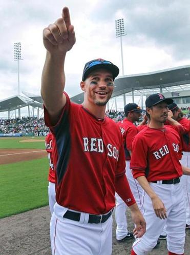 02/27/14: Ft. Myers, FL: Happy to be back.........Red Sox outfielder Grady Sizemore played in his first game in a long time, and after the national anthem, he smiled and waved to a friend in the stands as he headed back to the dugout. The Red Sox played their annual spring season opening double header, with games vs. Northeastern University and Boston College. () section:sports topic:Red Sox Spring Training
