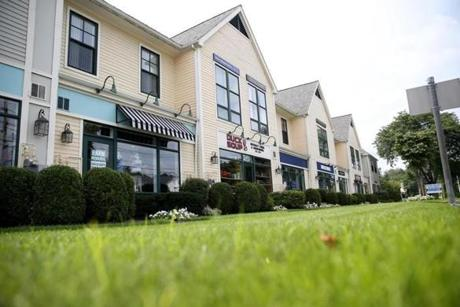 Route 20 in Sudbury includes plazas such as the Mill Village Shopping Center and the historic Wayside Inn.