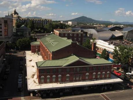 From the rooftop overlook at Center in the Square, the view includes the 1922 City Market Building and the Blue Ridge mountains in the distance.