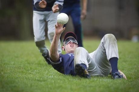 Joe, wearing the blindfold that levels the Beep Baseball playing field, drills in Watertown.