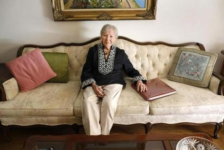 Pauline Herzek, pictured at her San Diego home with the family album, is planning to move to the Boston area.