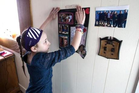 Caitlyn Rose Kasper hung a family history project she made in school on the wall of her home.