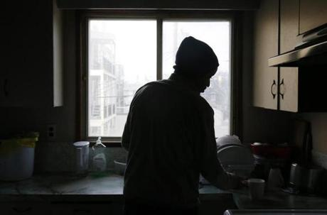 Winnipeg, Manitoba -- 3/23/2017 - Biniam Yemesghen, 34, of Eritrea (cq) makes tea in a tiny apartment that he is sharing with other asylum seekers in Canada. Yemesghen had hoped to receive asylum in the United States but was denied asylum status at a hearing in Florida. He was eventually released from the detention center and decided to flee to Canada. (Jessica Rinaldi/Globe Staff) Topic: Reporter: