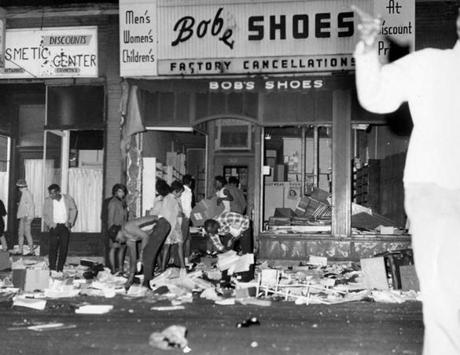 Boston, MA - 6/3/1967: People loot a store on Blue Hill Avenue during riots in the Roxbury neighborhood of Boston on June 3, 1967. (Tom Landers/Globe Staff) --- BGPA Reference: 140908_MJ_010