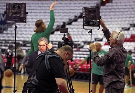 Camera crews set up along the court before Game 4.