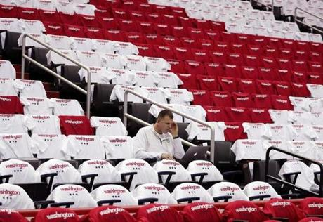 All the seats had been covered with a t-shirt by the time Celtics assistant coach Jay Larranaga found one to review video prior to Game 4.