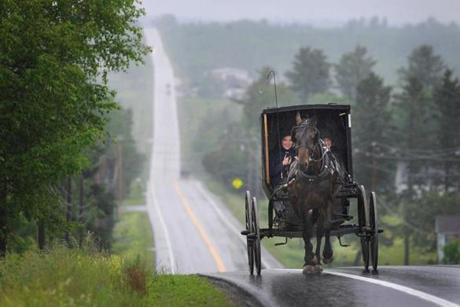 2017062317 Patten, Maine Photo by Fred J. Field The Amish use horse-drawn buggies while traveling in the towns just to the East of the Katahdin Woods and Waters National Monument area in Northern Maine. In this photo the Amish head south along Route 11 in Patten, Maine. The Amish contribute to the timeless beauty of the area.