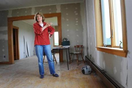 2017062317 Patten, Maine Photo by Fred J. Field Christina Shipps stands in what would have the dining room of a new cafe she was creating in Patten, Maine near the Katahdin Woods & Waters National Monument area. President Obama designated this area as a national monument. The Trump administration is reviewing that decision.