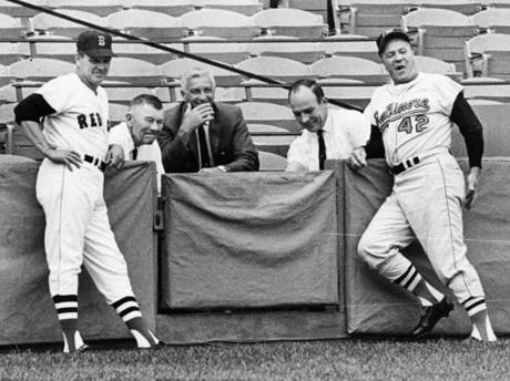 Boston, MA - 7/13/1967: Boston Red Sox manager Dick Williams, owner Tom Yawkey, Sam Mele, Haywood Sullivan, and Hank Bauer stand together at Fenway Park in Boston on July 13, 1967. (Dan Goshtigian/Globe Staff) --- BGPA Reference: 170705_MJ_002