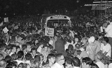 23sox67 - Part of the upwards to 10,000 persons at Boston's Logan Airport swarms around the bus carrying team members of the Boston Red Sox. The crowd overran police lines here 7/23 and swarmed on to the field. The Sox had returned from a successful road trip. (Bettmann Archive)