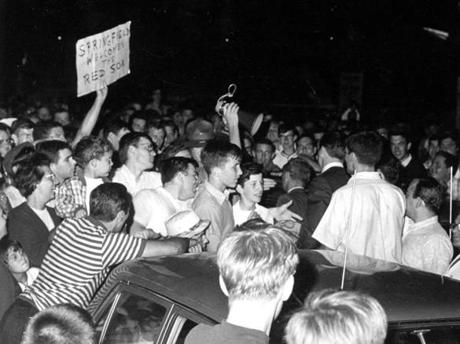 Fans gather at Logan Airport to greet the Red Sox as they return from a successful west coast trip in 1967.